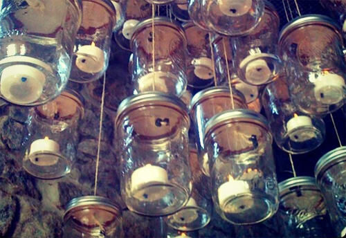 Chandelier made from candles in jars