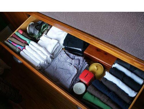 """File"" clothing in drawers for easy access"