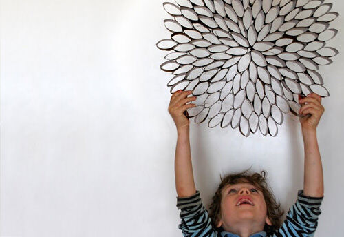 Make wall art from toilet paper rolls