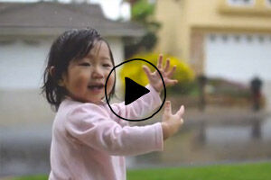 Toddlers amazed at the rain