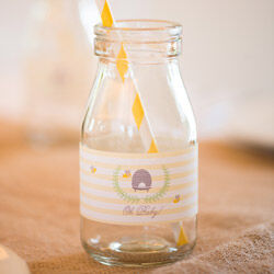 Mini milk bottles from The Party Parlour ($2.50 ea), personalised labels by Love JK ($1.49 per label)