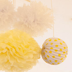 Pom poms and lanterns from The Party Parlour