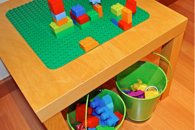 Add hooks and buckets to the LACK table for instant easy LEGO storage