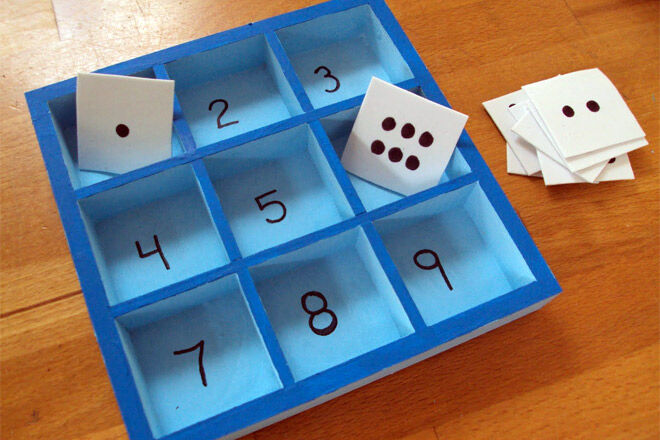 Numeracy game with boxes