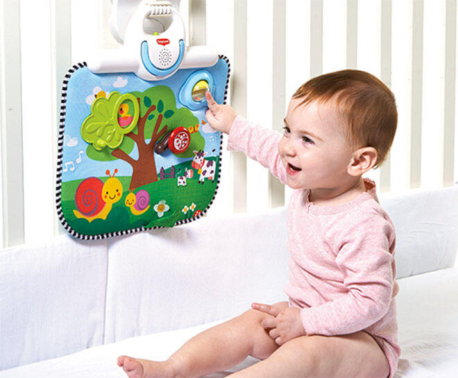 Award winning double sided crib toy plays when babies away