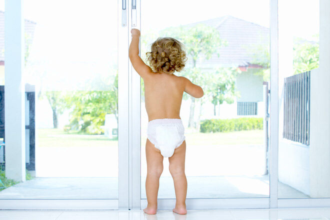 Toddler escaping out the Door
