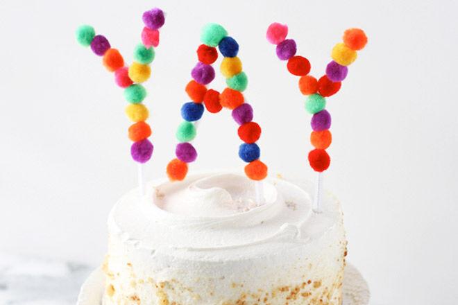 DIY Pom Pom Cake Topper Tutorial via Momtastic