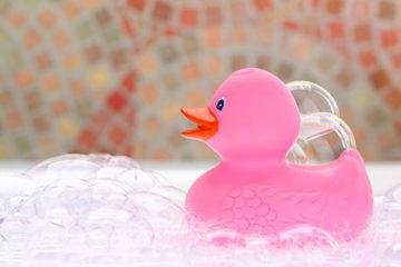 Pink rubber ducky in bath