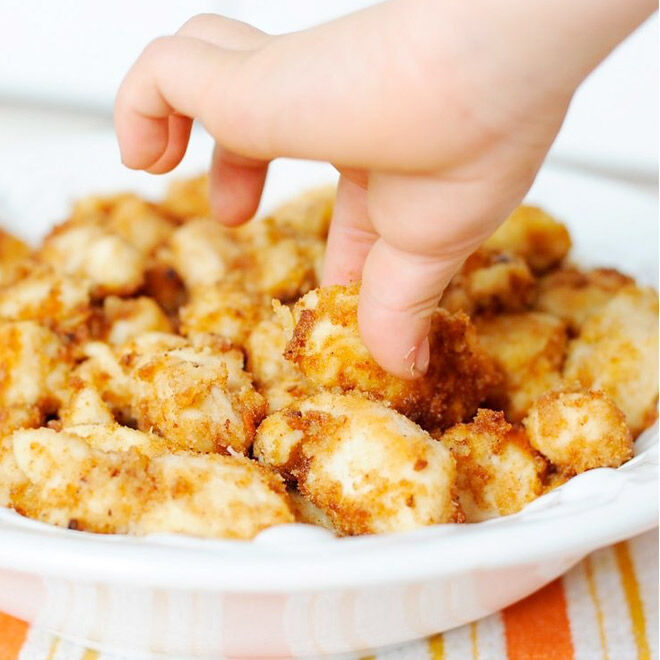 Coat chicken with coconut for super crunchy, tasty chicken nuggets!