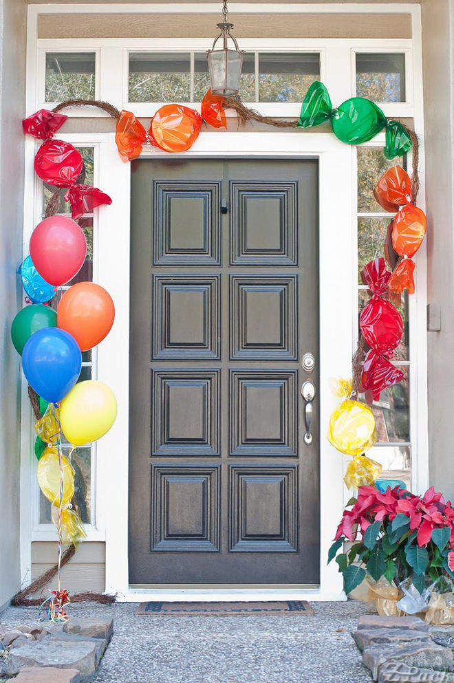 Paper plates and cellophane are used to make this front door look like lolly heaven for the little ones.