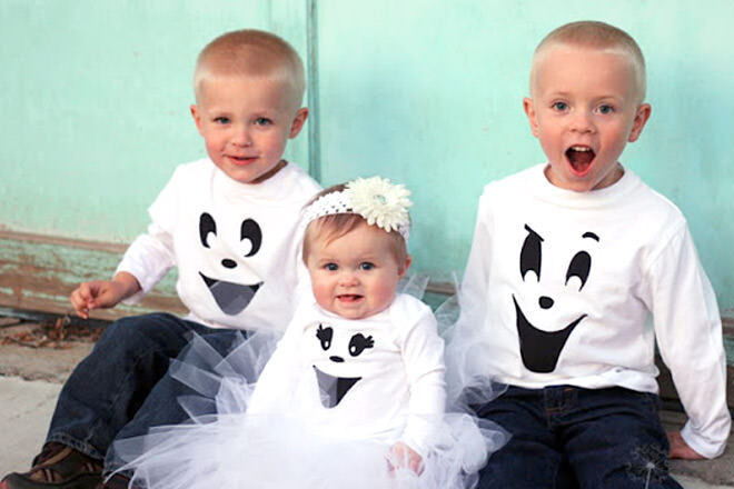 A stencil and black paint can turn kids into the spookiest and happiest ghosts around!