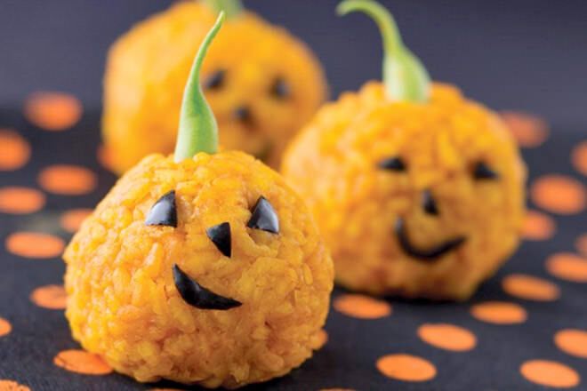 Coloured with carrot juice rather than food colouring, these rice balls make the perfect side to your nipper's haunted house tucker.