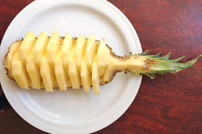 Cut a pineapple into quarters, cut out the flesh and slice into chunks. Perfect for a healthy party treat.