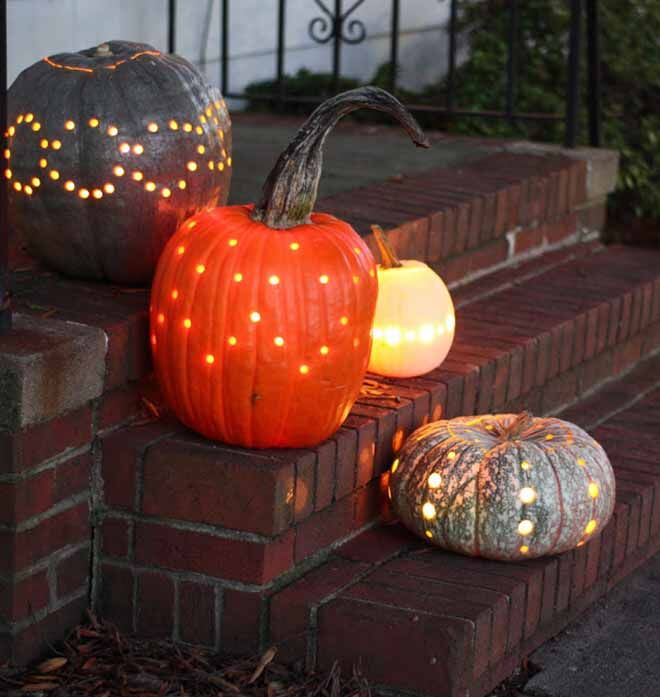 Can't calve a pumpkin? Easy - drill holes instead! Simple Halloween porch decoration.