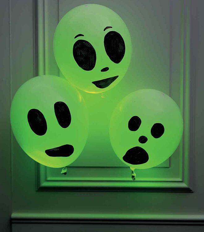Chuck a glow stick in a balloon and draw a face on it. Simple spooky DIY for Halloween
