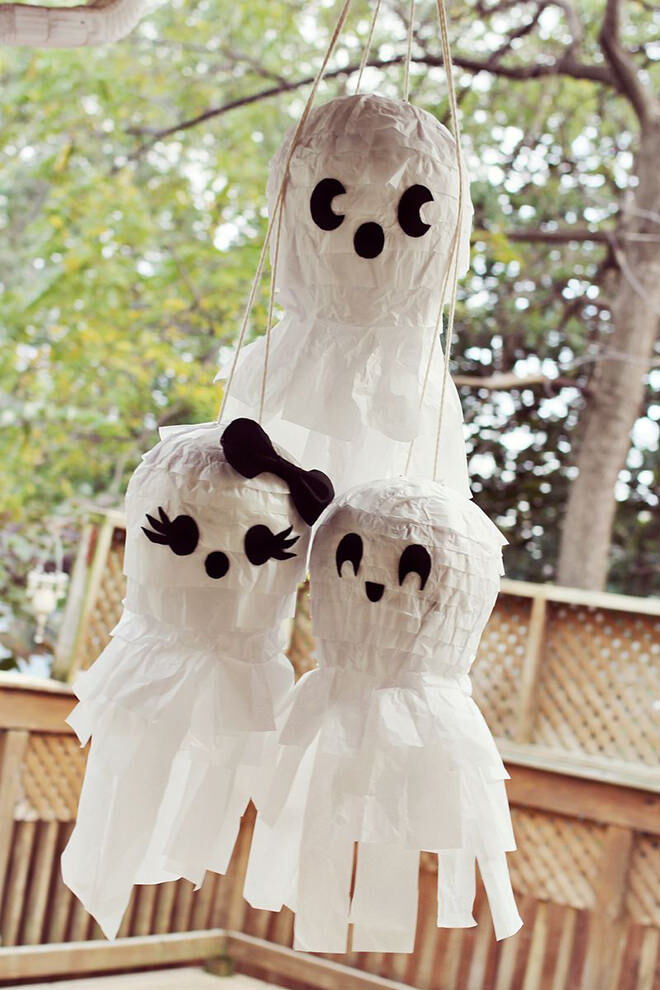 Ghosts aren't that scary when they're full of lollies. Awesome Halloween pinata idea!