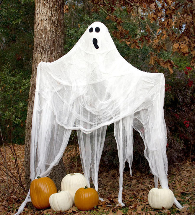 Cheesecloth makes the easiest and scariest ghosts for the back yard.