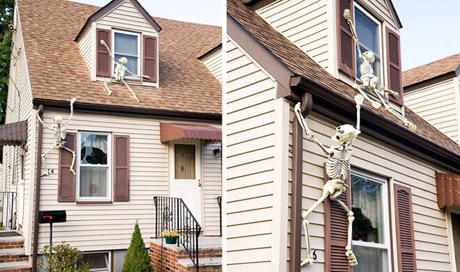 Plastic skeletons look like they're trying to climb into your house. Creepy!