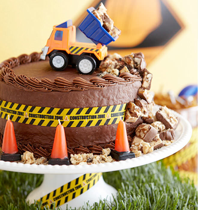A Construction Cake Dumping Chocolate We Want One
