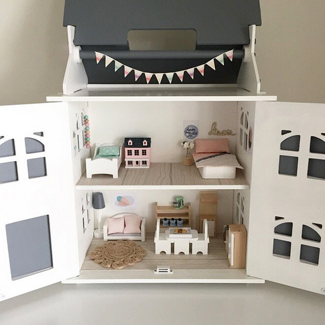A very pink Kmart dollhouse has been sanded back and turned into a miniature contemporary dream home. LOVE