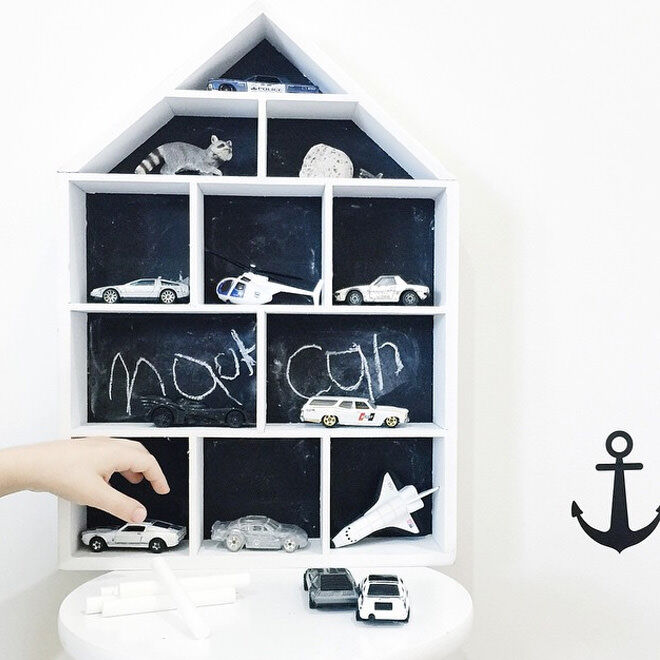 Remove the floral backing from the house-shaped shadow box, paint with chalkboard and use as a fun garage for the kids cars!