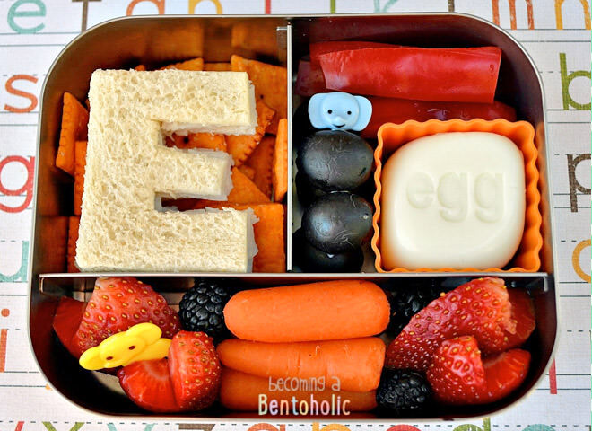 Make their lunch box extra special with a cut out sandwich in the shape of the first letter of their name