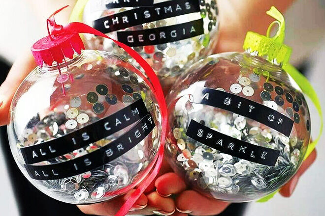 We love these colourful neon baubles filled with sequins and adorned with Christmas wishes!