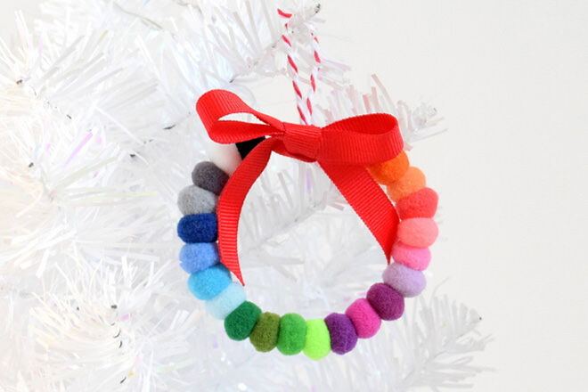 Grab your colourful pom poms and thread them onto some wire to make this colourful wreath ornament.