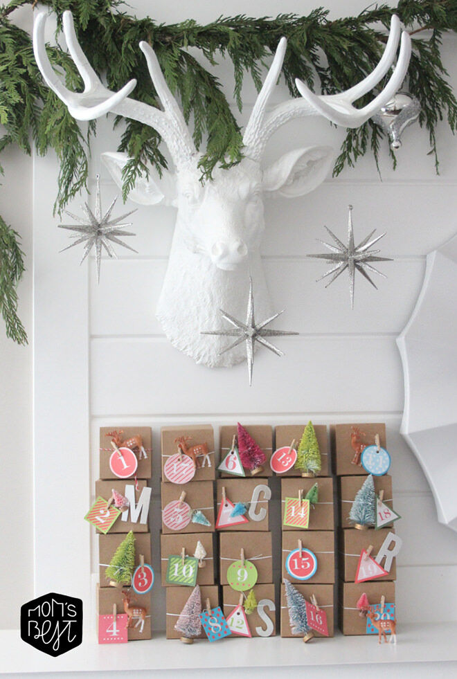 Grab a bunch of mini gift boxes, string, numbers and some little ornaments to make this advent calendar.