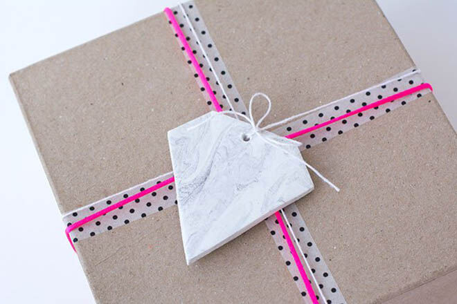 Crate a clay tag and add neon string for some super cool gift wrap