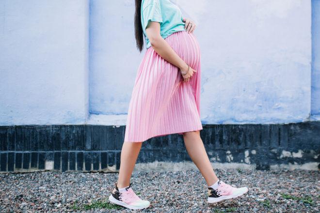 Pregnant walking pink skirt