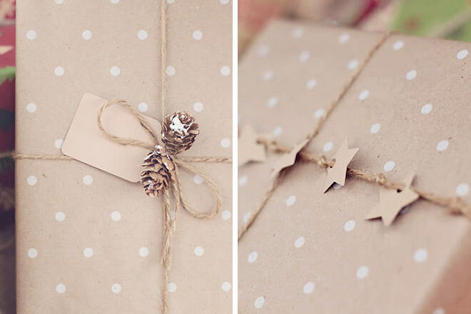 Simple star and pine cone Christmas gift wrapping with brown paper