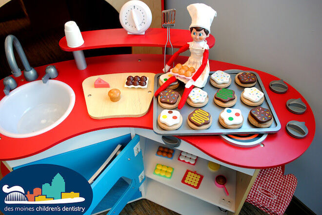 Elf on the Shelf cooking in a toy kitchen