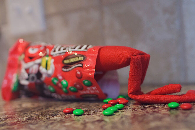 Elf on the Shelf getting his lolly fix