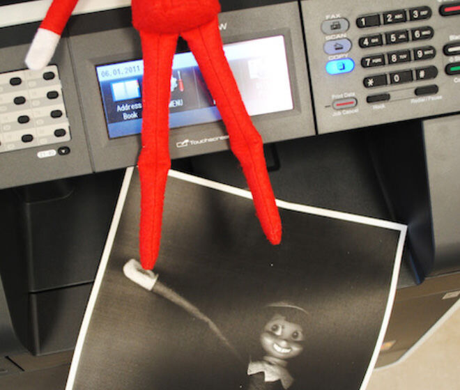 Elf on the Shelf photocopying at the office