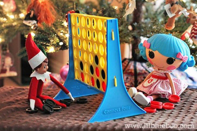 Elf on the Shelf playing Connect 4