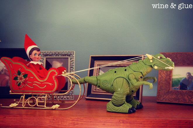 Elf on the Shelf takes a dinosaur ride