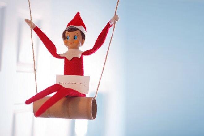 Elf on the Shelf on a toilet roll swing