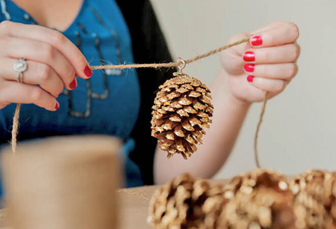 Add a little gold paint to pinecones for a fancy garland