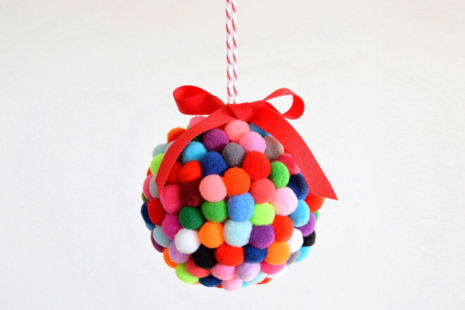 Grab some colourful mini pom poms and stick them onto a foam ball with some craft glue for this cute bauble
