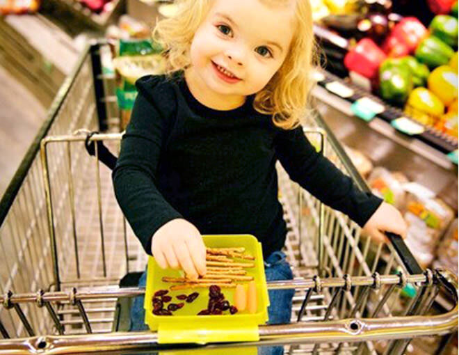 The trolley snack tray makes shopping with a peckish little one so much easier
