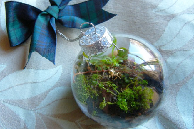 Hunt down greenery and get your hands dirty to create these mini terrarium baubles.