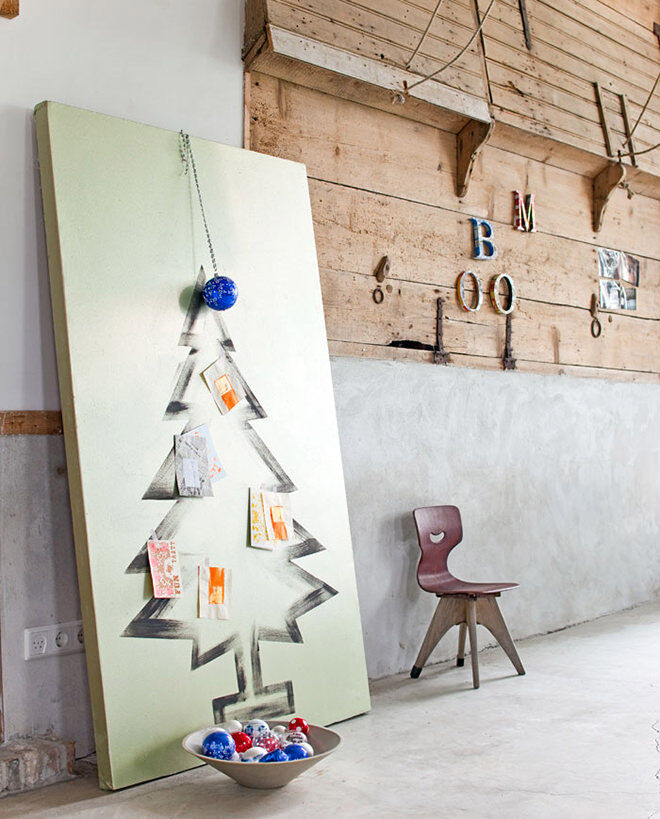 Paint a Christmas tree onto a large canvas for a hassle free decoration