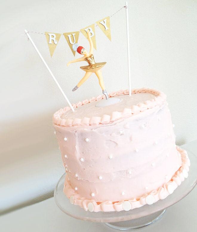 Cherry vanilla ballerina cake with bunting