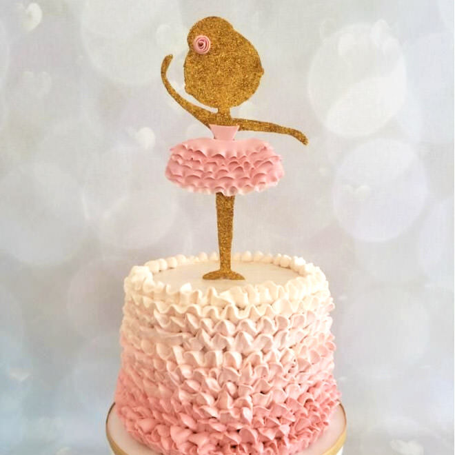 Ballerina cake with gold and pink cake topper