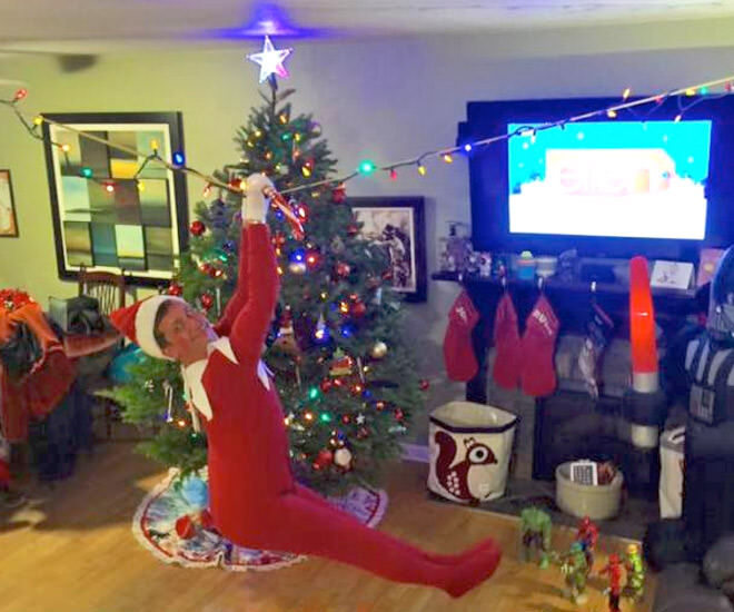 Dad turns into Elf on the Shelf