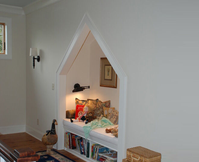 Alcoves in the hallways can be used to create a sweet reading nook just like this one