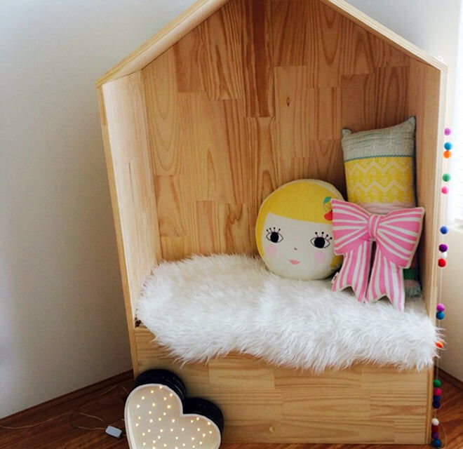 Ply wood house makes a cute reading nook for little ones