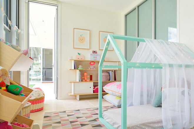 Pastel green kids bed frame with fairy lights