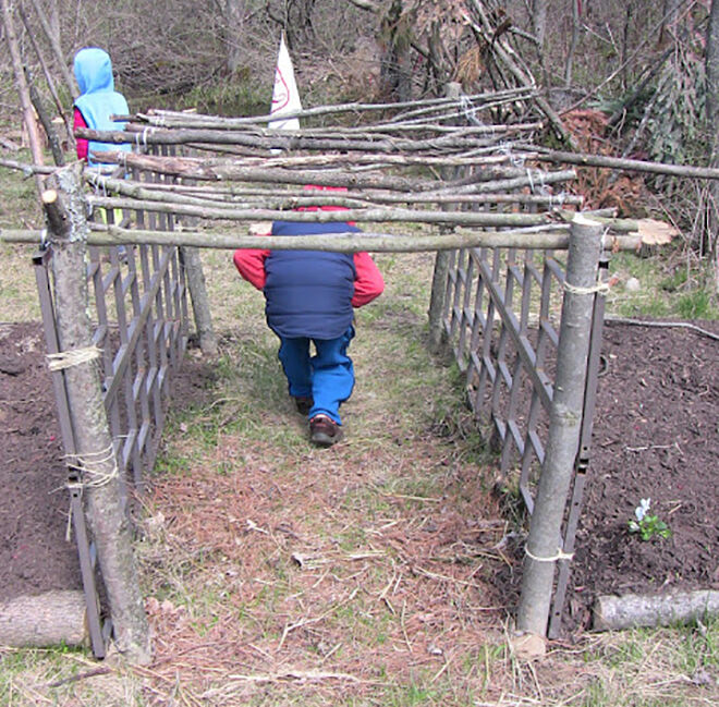 Natural tunnel. Outdoor play ideas.